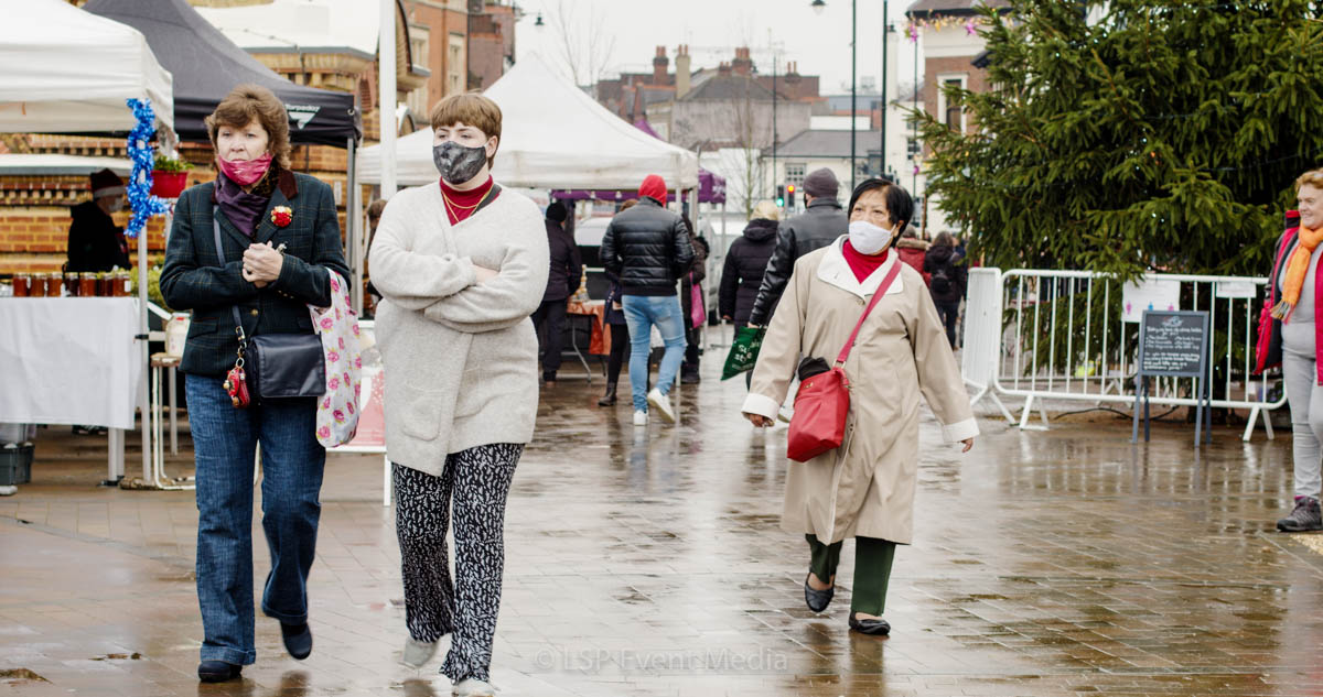 Three women wearing masks at the Farmers Market Epsom