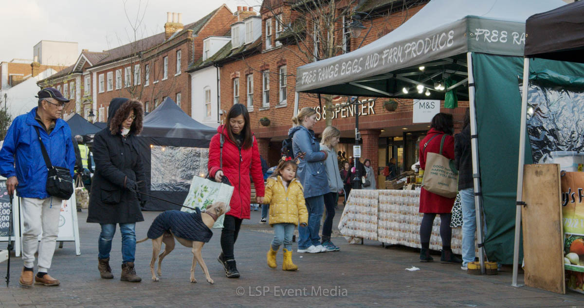 An oriental family visiting the Farmers Market in Epsom