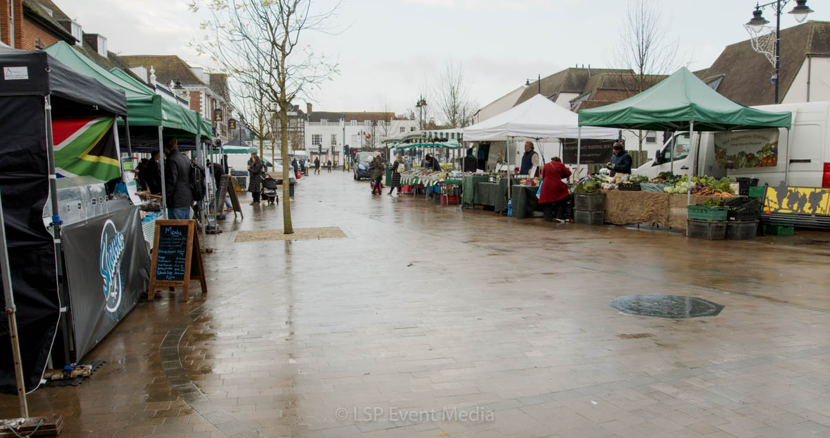 Rain drenched the street in the Farmers Market in Epsom